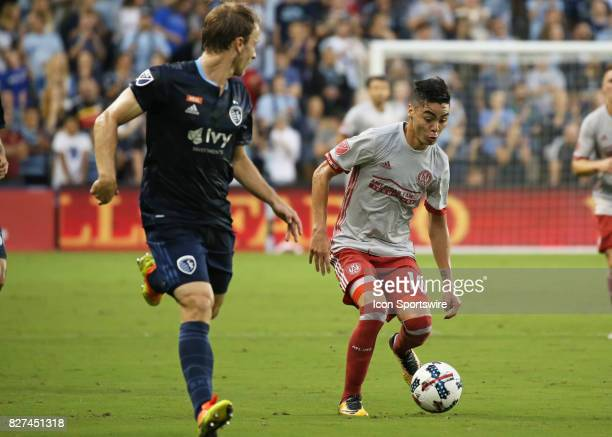 Atlanta United midfielder Miguel Almiron looks to get past Sporting Kansas City defender Seth Sinovic in the first half of an MLS match between...