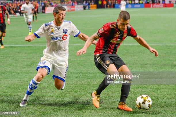 Atlanta's Carlos Carmona keeps the ball away from Blerim Dzemaili during the match between Atlanta United and the Montreal Impact on September 24...