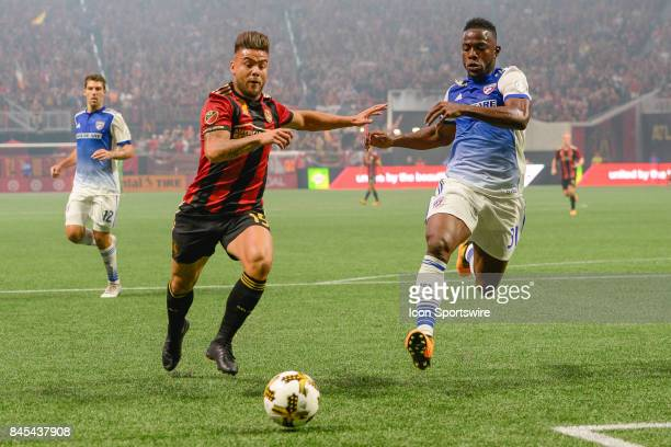 Atlanta's Hector Villalba and Dallas defender Nano Figueroa race to the ball during a match between Atlanta United and FC Dallas on September 10 2017...