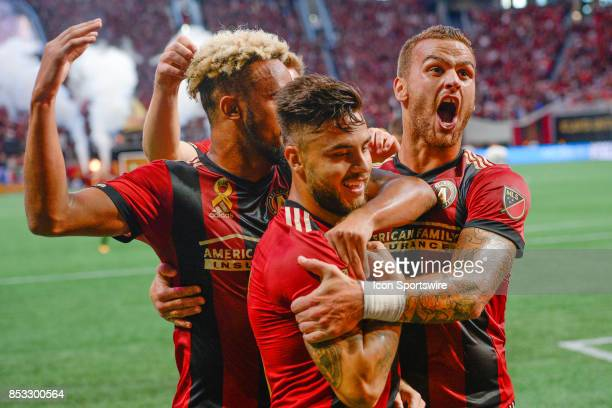 Atlantas Hector Villalba celebrates his goal with teammate Leandro González Pirez and Anton Walkes during the first half of the match between Atlanta...