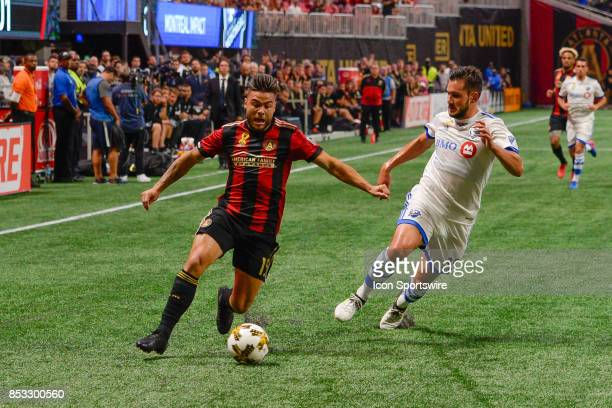 Atlantas Hector Villalba moves past Montreal defender Deian Boldor during the first half of the match between Atlanta United and the Montreal Impact...
