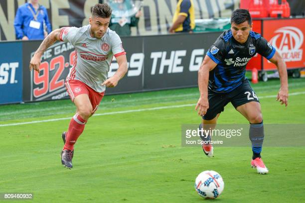 Atlanta's Hector Villalba moves the ball towards the goal while guarded by San Jose's Nick Lima during a match between the San Jose Earthquakes and...
