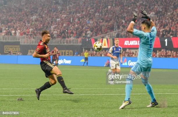 Atlanta's Hector Villalba takes a shot on goal while Dallas goalkeeper Jesse Gonzalez defends during a match between Atlanta United and FC Dallas on...
