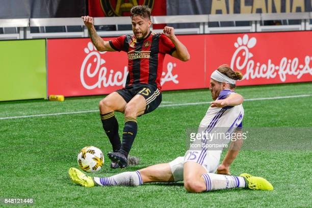 Atlanta's Hector Villalba us defended by Orlando's Dillon Powers during a match between Atlanta United and the Orlando City on September 16 2017 at...