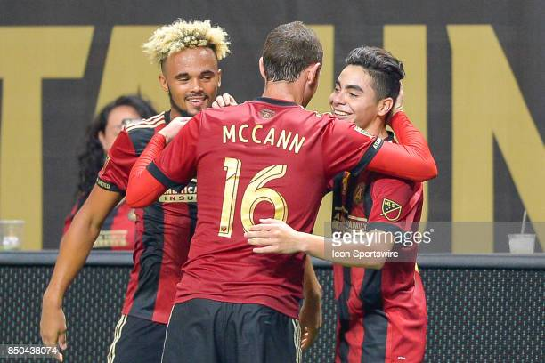 Atlanta's Miguel Almiron is congratulated by teammates Chris McCann and Anton Walkes after scoring a goal during a match between Atlanta United and...