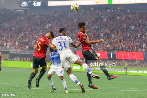 Atlanta's Yamil Asad and Hector Villalba fight with Maynor Figueroa from Dallas for possession during a match between Atlanta United and FC Dallas on...