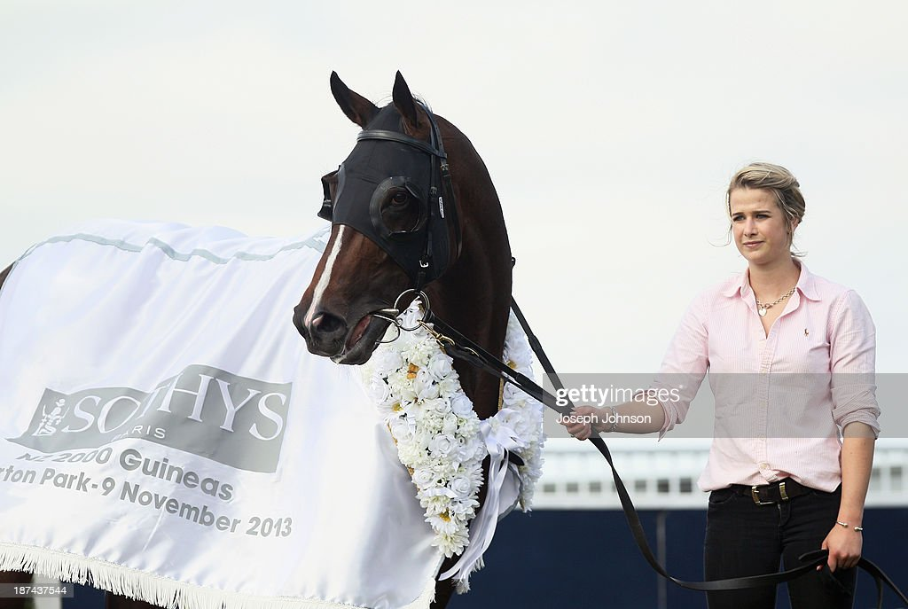 Atlante with strapper Emily Murray after winning the Sothys 41st New Zealand 2000 Guineas race during New Zealand 2000 Guineas Day on November 9, 2013 in Christchurch, New Zealand.