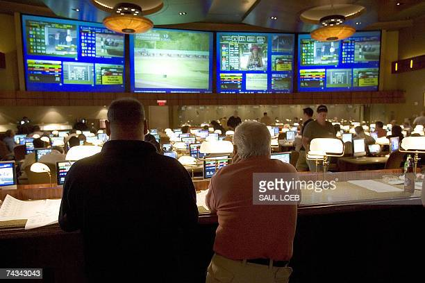 Players watch horse racing at the Race Book at the Borgata Hotel Casino and Spa in Atlantic City New Jersey 25 May 2007 The hotel which opened in...