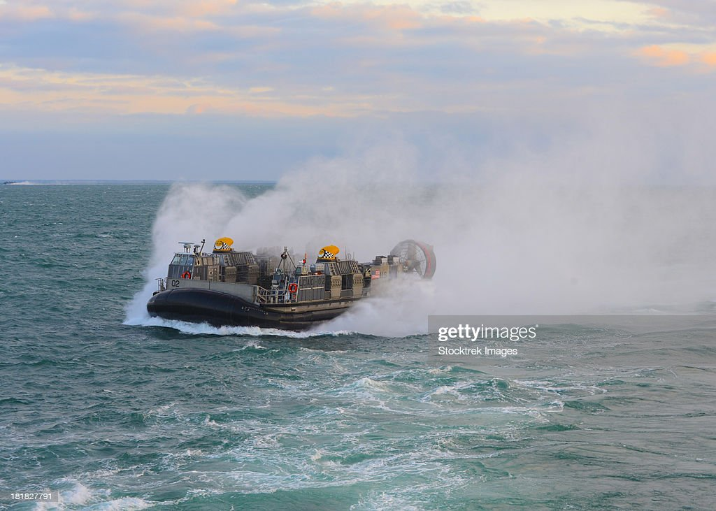 Atlantic Ocean, March 13, 2013 - A landing craft air cushion (LCAC) enters the well deck of the amphibious dock landing ship USS Carter Hall.
