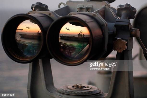 Atlantic Ocean, November 4, 2005 - The Nimitz-class aircraft carrier USS Dwight D. Eisenhower is reflected in a set of Big Eyes binoculars on the signal bridge of the Nimitz-class aircraft carrier USS Harry S. Truman.