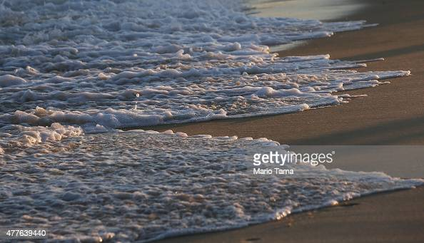 Atlantic Ocean waves wash up on Ipanema beach on June 18 2015 in Rio de Janeiro Brazil Pope Francis' encyclical on climate change 'Laudato Si' calls...