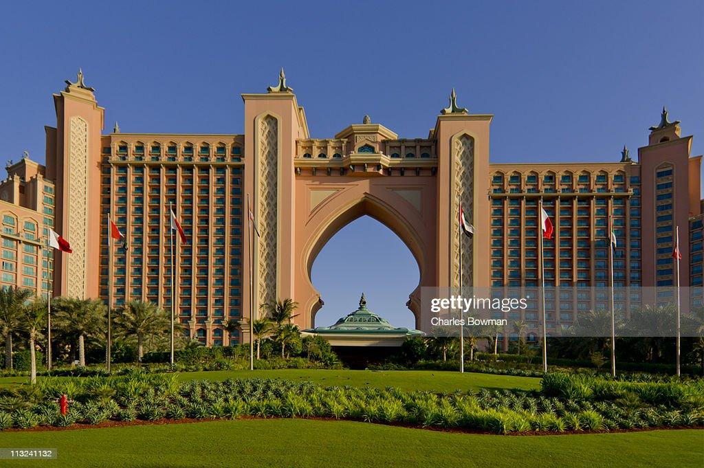 Atlantis Hotel Dubai looms behind lush garden