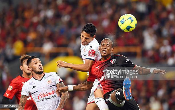 Atlas player Leiton Jimenez jumps for the ball with Raul Ruidiaz of Morelia during their Mexican Clausura 2017 tournament football match at Jalisco...