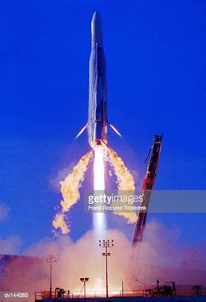 Atlas-F rocket blasting off