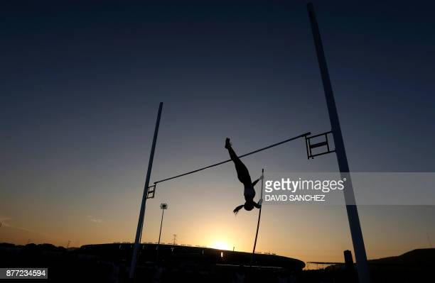TOPSHOT Atlethes compete during the women's pole vault event during the XVIII Bolivarian Games in Santa Marta Colombia on November 21 2017 / AFP...