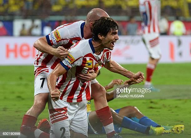 Atletico de Kolkata defender Henrique Fonseca Sereno celebrates after he scored a goal against Kerala Blasters FC during the final Indian Super...