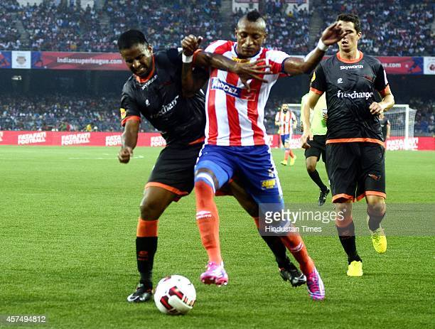 Atletico de Kolkata footballer Fikru Lemessa vying for ball with Delhi Dynamos FC player during the Indian Super League football match between...