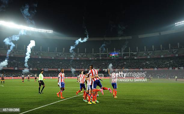 Atletico de Kolkata footballers celebrate a goal by teammate Joffre Gonzalez during the Indian Super League football match between Atletico de...