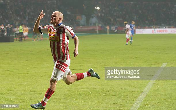 Atletico de Kolkata forward Iain Edward Hume celebrates after scoring a goal during the Indian Super League football semifinal match between Atletico...
