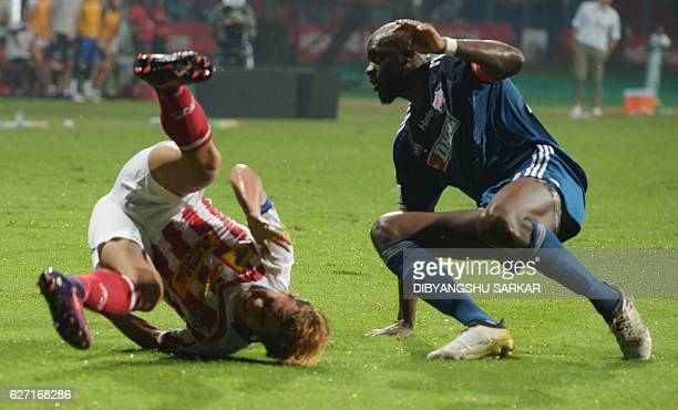 Atletico de Kolkata midfielder Bidyananda Singh vies for the ball with FC Pune City midfielder Mohammed Sissoko during the Indian Super League...