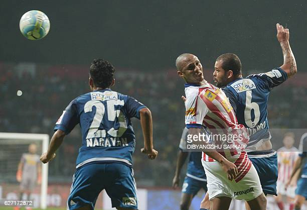Atletico de Kolkata midfielder Ofentse Nato vies for the ball with FC Pune City defender Eduardo Ferreira during the Indian Super League football...