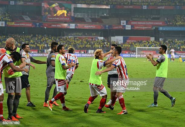 Atletico de Kolkata players celebrate after winning the Indian Super League final football match against Kerala Blasters FC at the Jawahar Lal Nehru...