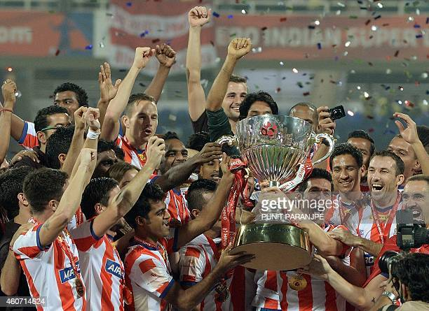 Atletico de Kolkata team players celebrate after winning the Indian Super League final football match against Kerala Blasters at The DY Patil stadium...