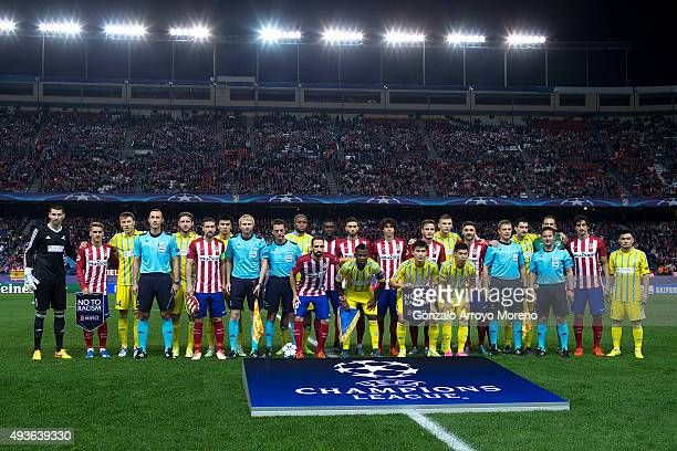Atletico de Madrid and FC Astana pose for a temam photo holding the UEFA No To Racism pennant prior to start the UEFA Champions League Group C match...