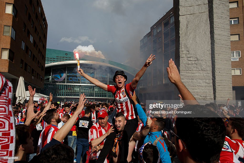Atletico de Madrid fans cheer their team outside the Barclaycard Center before the UEFA Champions League Final match between Real Madrid CF and Club Atletico de Madrid on May 28, 2016 in Madrid, Spain. Real Madrid CF and Atletico de Madrid play the final match of the UEFA Champions League in Milan.