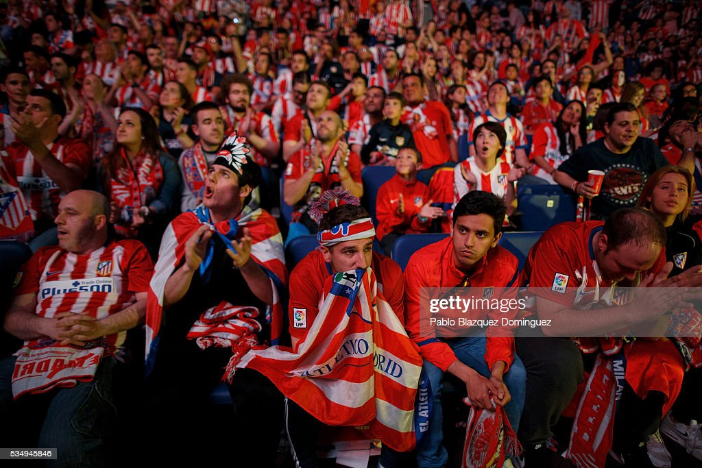 Atletico de Madrid fans react as they watch the UEFA Champions League Final match between Real Madrid CF and Club Atletico de Madrid at Barclaycard Center before on May 28, 2016 in Madrid, Spain. Real Madrid and Atletico de Madrid play the final match of the UEFA Champions League in Milan.