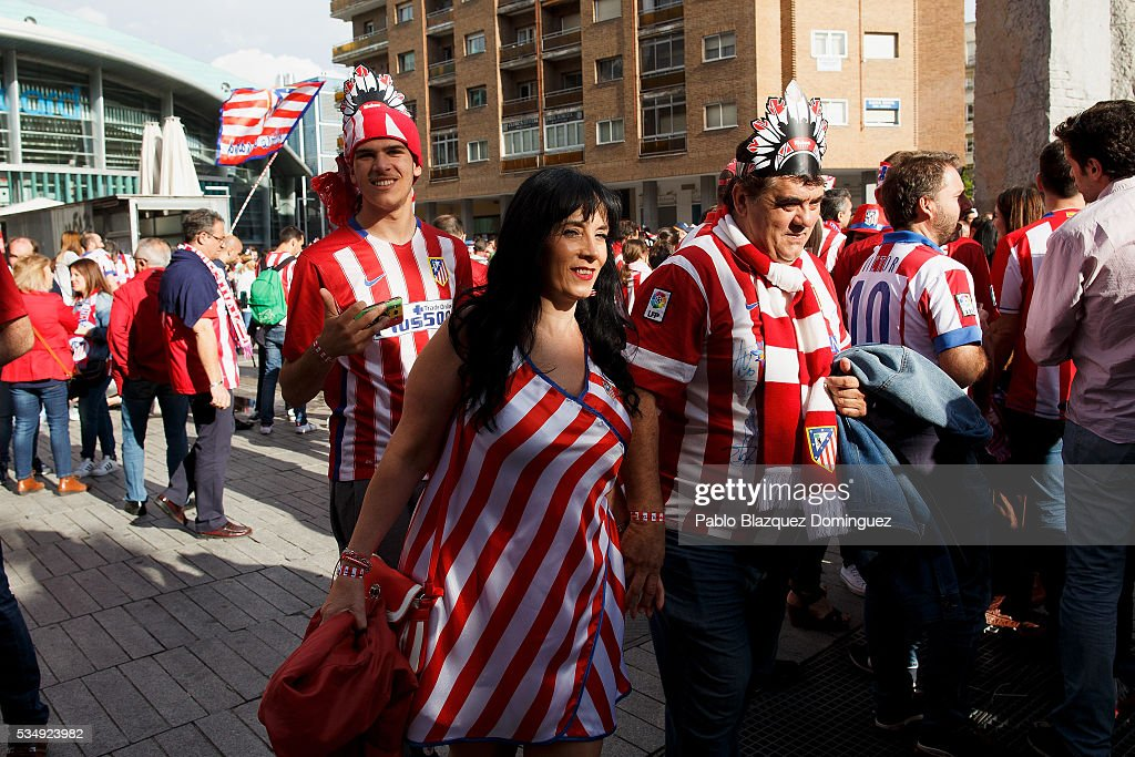Atletico de Madrid fans walks outside the Barclaycard Center before the UEFA Champions League Final match between Real Madrid CF and Club Atletico de Madrid on May 28, 2016 in Madrid, Spain. Real Madrid and Atletico de Madrid play the final match of the UEFA Champions League in Milan.