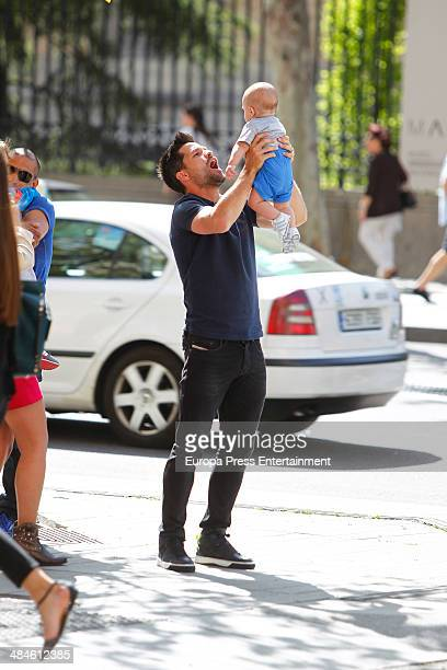 Atletico de Madrid football player Diego Ribas and his son are seen on April 11 2014 in Madrid Spain
