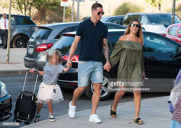Atletico de Madrid football player Fernando Torres his wife Olalla Dominguez and their daughter Nora Torres are seen on September 6 2016 in Madrid...