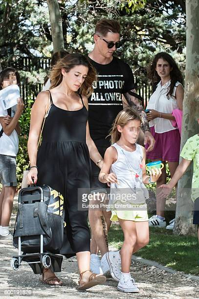 Atletico de Madrid football player Fernando Torres his wife Olalla Dominguez and their daughter Nora Torres are seen on September 7 2016 in Madrid...