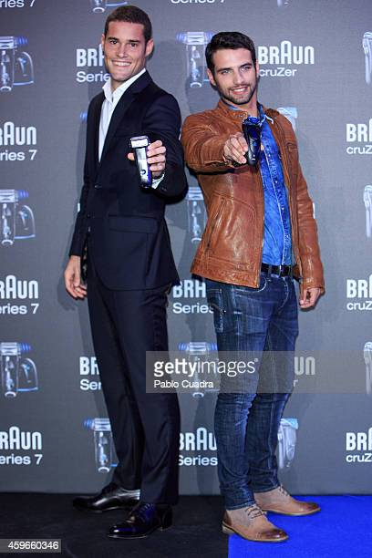 Atletico de Madrid football player Mario Suarez and actor Jesus Castro pose during a photocall to presents a new Braun shaver on November 27 2014 in...