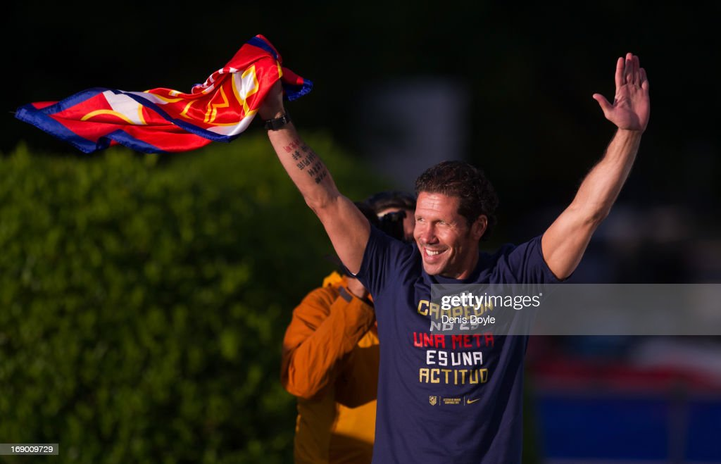 Atletico de Madrid head coach <a gi-track='captionPersonalityLinkClicked' href=/galleries/search?phrase=Diego+Simeone&family=editorial&specificpeople=226872 ng-click='$event.stopPropagation()'>Diego Simeone</a> waves to supporters during celebrations a day after winning the Copa del Rey Final against Real Madrid on May 18, 2013 in Madrid, Spain.