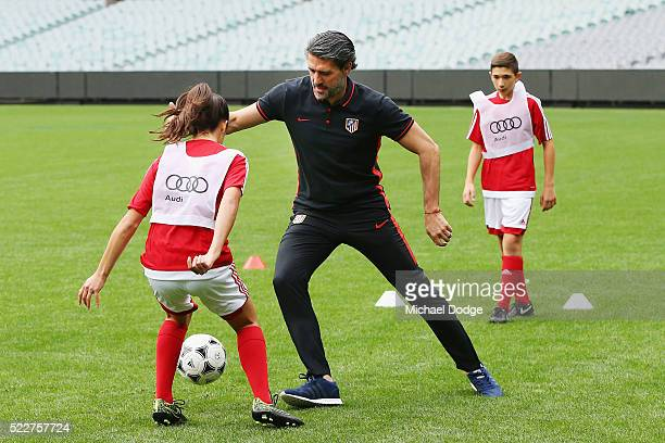 Atletico de Madrid Jose Luis Perez Caminero takes part in a clinic with junior footballers during the International Champions Cup Australia Media...