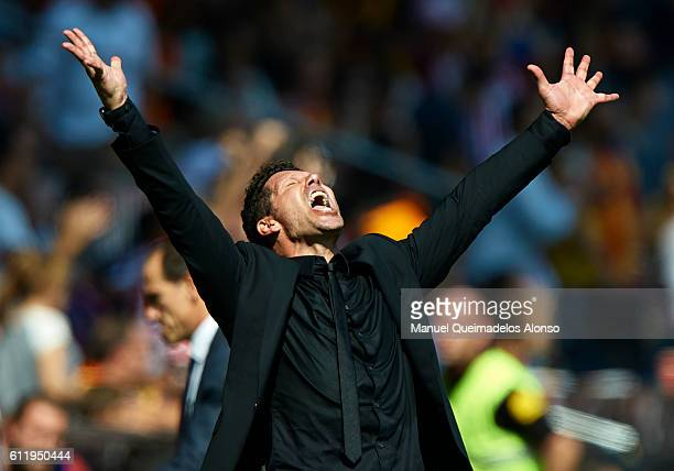 Atletico de Madrid manager Diego Pablo Simeone celebrates the second goal during the La Liga match between Valencia CF and Atletico de Madrid at...