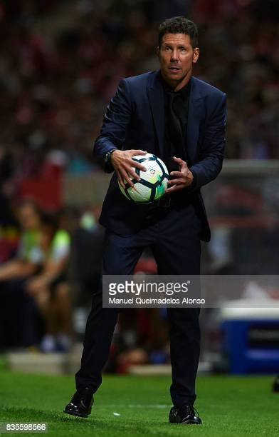 Atletico de Madrid manager Diego Pablo Simeone takes a ball during the La Liga match between Girona and Atletico Madrid at Municipal de Montilivi...