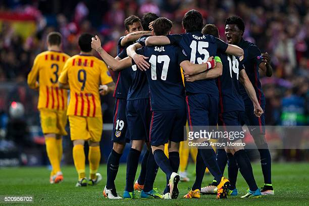 Atletico de Madrid players celebrate their victory ahead FC Barcelona ones after the UEFA Champions League quarter final second leg match between...