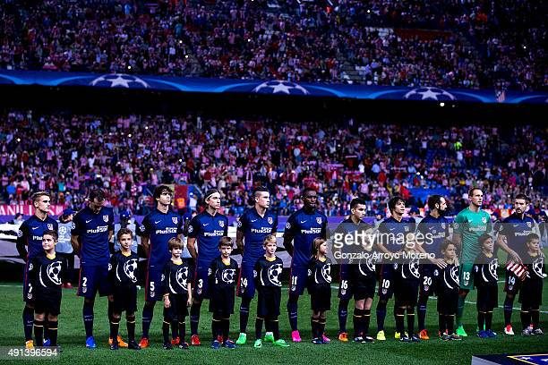 Atletico de Madrid team stands as they listen the UEFA Champions League hymn prior to start the UEFA Champions League Group C match between Club...