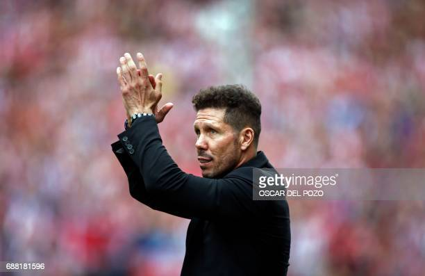 Atletico de Madrid's Argentinian coach Diego Pablo Simeone claps during a celebration bidding farewell to the team's stadium after the Spanish league...