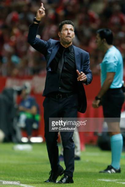 Atletico de Madrid's Argentinian coach Diego Simeone gestures from the sideline during the Spanish league football match Girona FC vs Club Atletico...