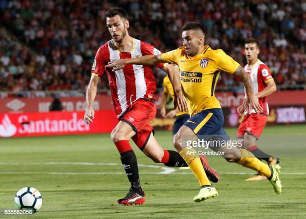 Atletico de Madrid's Argentinian forward Angel Correa vies with Girona's defender Pedro Alcala during the Spanish league football match Girona FC vs...