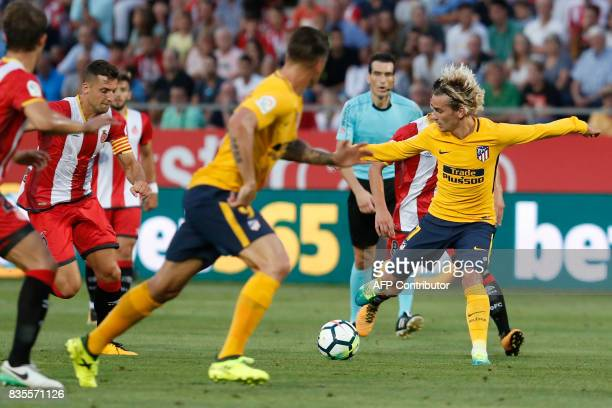 Atletico de Madrid's French forward Antoine Griezmann controls the ball during the Spanish league footbal match Girona FC vs Club Atletico de Madrid...
