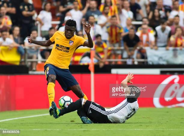 Atletico de Madrid's Ghanaian midfielder Thomas Partey vies with Valencia's defender from Spain Jose Luis Gaya Pena during the Spanish Liga football...