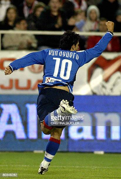 Atletico de Madrid's Kun Aguero celebrates after scoring against Sevilla during a Spanish league football match at the Sanchez Pizjuan stadium in...