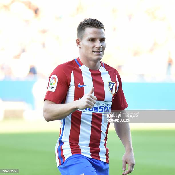 Atletico de Madrid's new signing French forward Kevin Gameiro poses during his presentation at the Vicente Calderon stadium in Madrid on July 31 2016...