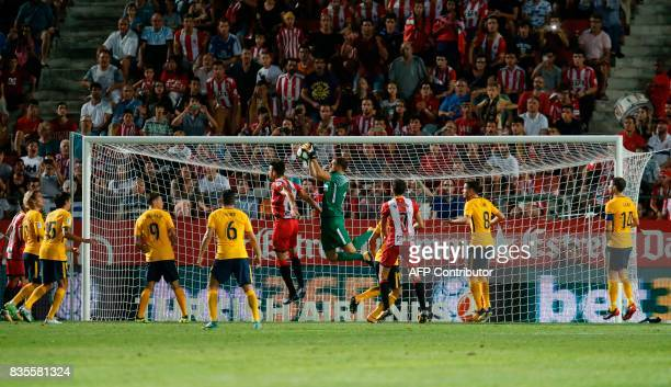 Atletico de Madrid's Slovenian goalkeeper Jan Oblak catches the ball during the Spanish league football match Girona FC vs Club Atletico de Madrid at...