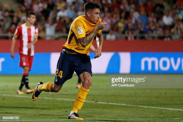 Atletico de Madrid's Uruguayan defender Jose Gimenez celebrates after scoring during the Spanish league football match Girona FC vs Club Atletico de...